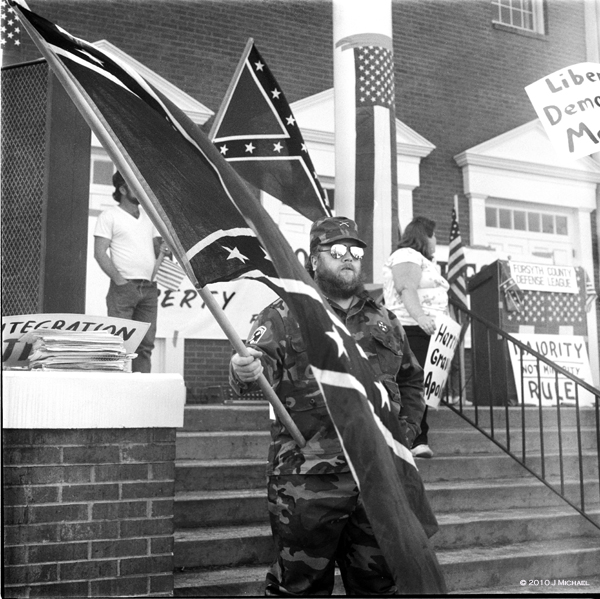 Man holding Confederate flag